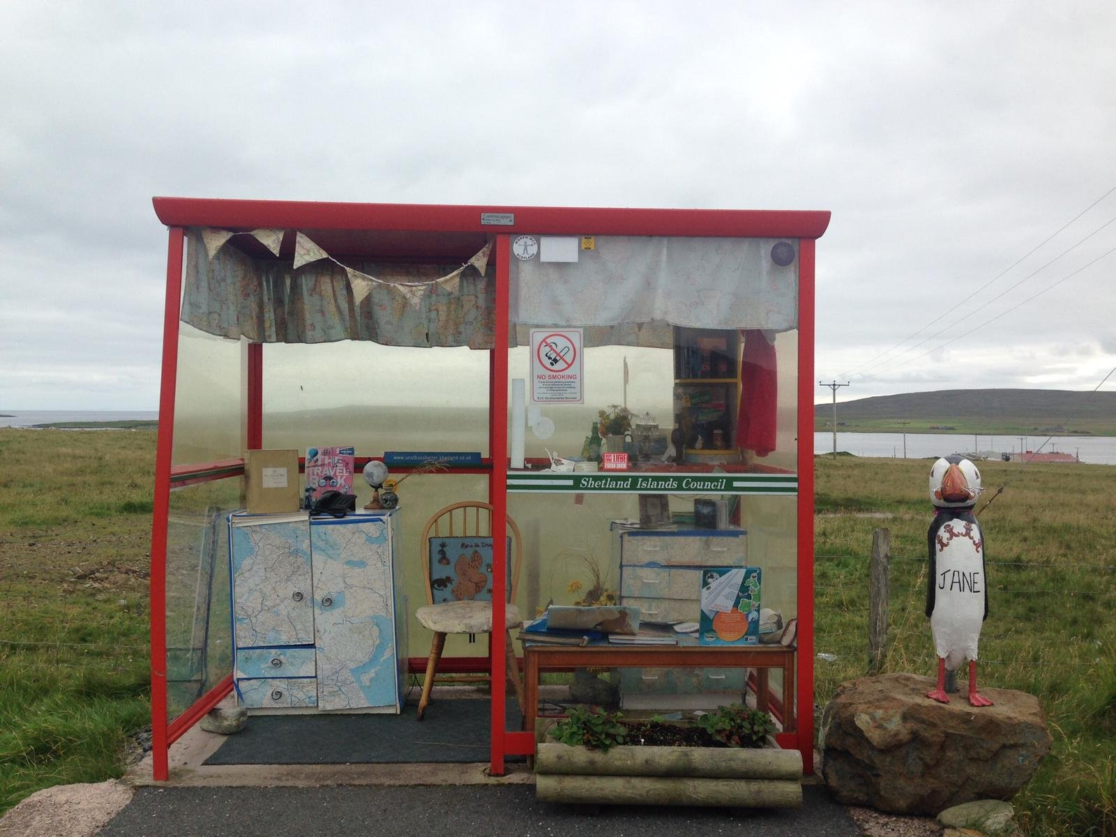 Highly decorated bus shelter with memorabilia from around the world
