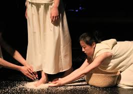 Two performers put rice around another's feet in Edinburgh Fringe show